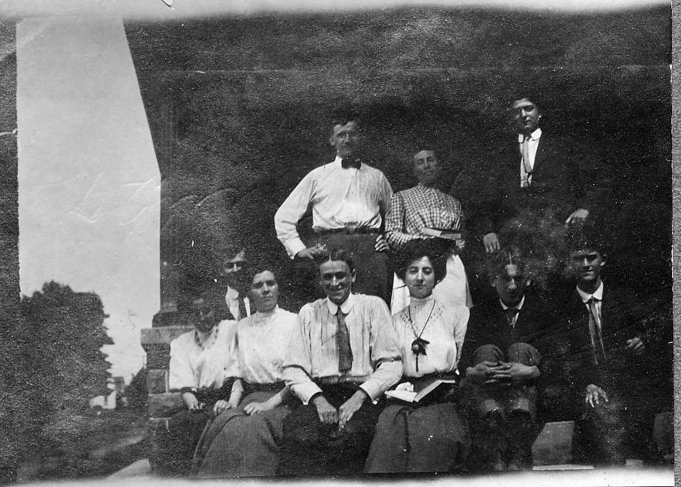 Group, 3 in back standing, 7 seated.