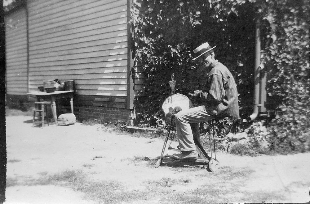 Man sharpening a tool.