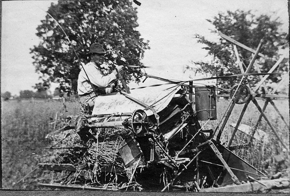 Man operating farm equipment