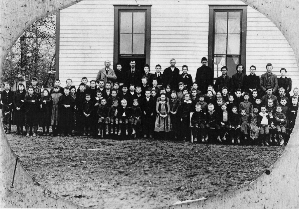 The new Freetown two story school was built in 1889 and this picture was taken shortly thereafter. Front 3rd from left - Jim Smith, 4th from right in polka dot dress - May (Lucas) Hayes. Back row in middle Albert Delong. Rest are unidentified. - from Winfred (Bud) Cornett, bw 7.17x10.