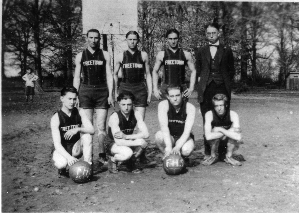 1925 Mens Basketball Team, Freetown High School, Freetown, IN, R-L: row 1: Loyd Spurgeon, Jr., Edgar Spurgeon, Wm. (Bill) Myers, and Earnest Spurgeon. Row 2 L-R: Merrill Huber, John Lucas, George Bebout, and coach Ralph Denny. - from Freida Duchaine, bw 4.77x3.39
