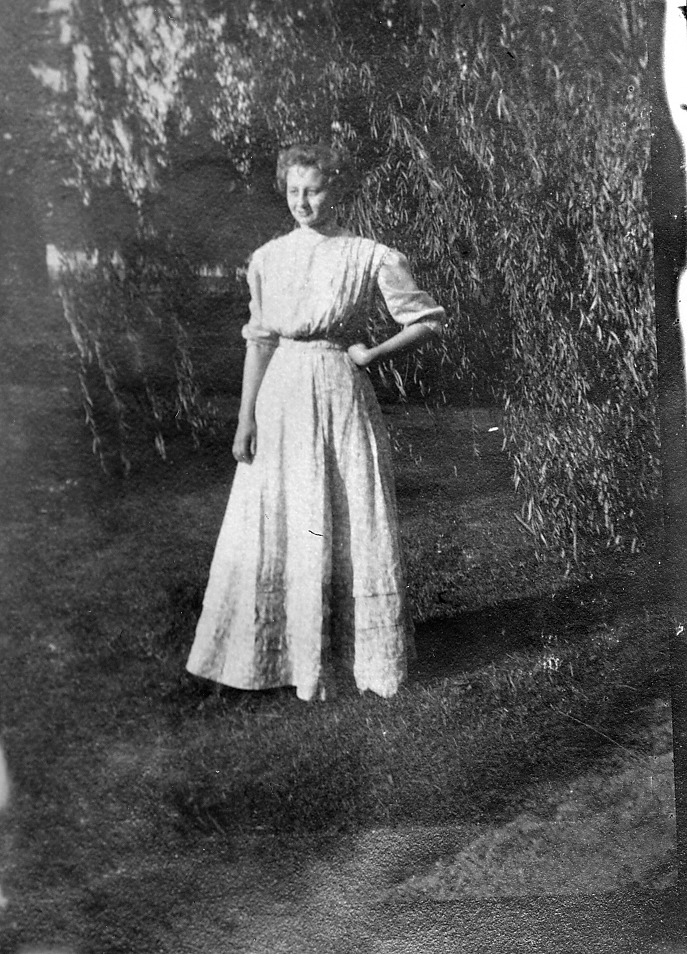 lady standing in front of tree