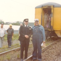 Al Lucas and Russell Brock - last run of the CSX-Chessie Passenger Conductor, Seymour Depot 12-16, 1980. - from Sara Marling Lucas, color 4.09 x 3.08