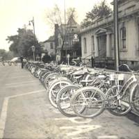 Bicycles line West Second in front of the American Legion Post, probably 1950s. The Grubb house in background later became business offices. Former Hunterman residence in far background became physician offices. North side of West Second Street at Walnut in Seymour IN
